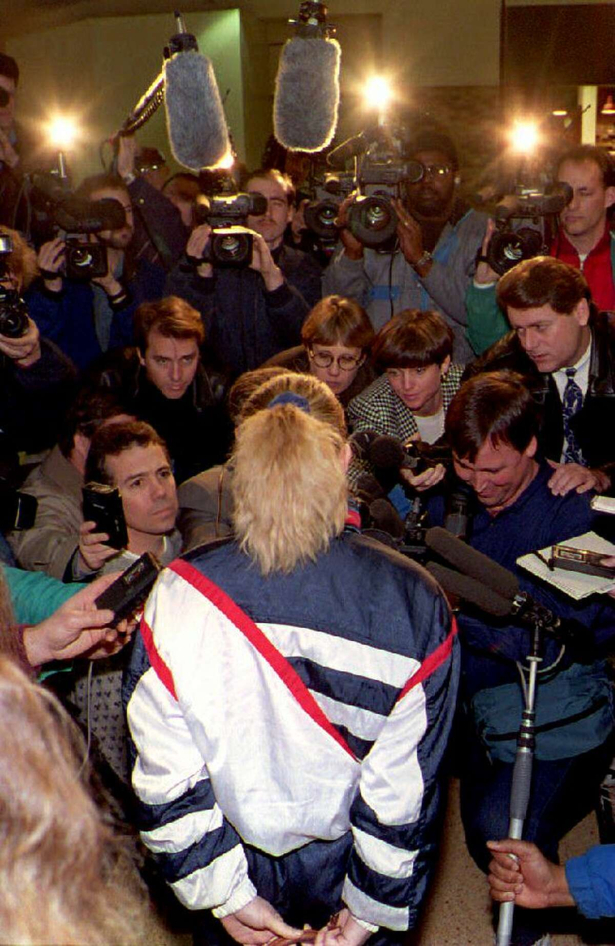 The media attention began after the Jan. 6, 2004, attack on Kerrigan. Here Tonya Harding faces reporters on Jan. 20, 1994, in Portland.