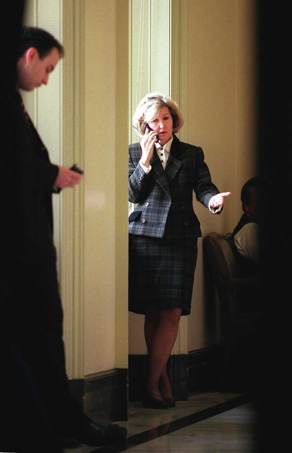 US Senator Kay Bailey Hutchison, (R-TX), talks on a cell phone on Capitol Hill 08 February in Washington, DC before the continuation of the impeachment trial of US President Bill Clinton. The defense and prosecution will deliver closing arguments in Clinton's trial on charges of obstruction of justice and lying to a grand jury. Photo: MARIO TAMA, AFP/Getty Images / AFP