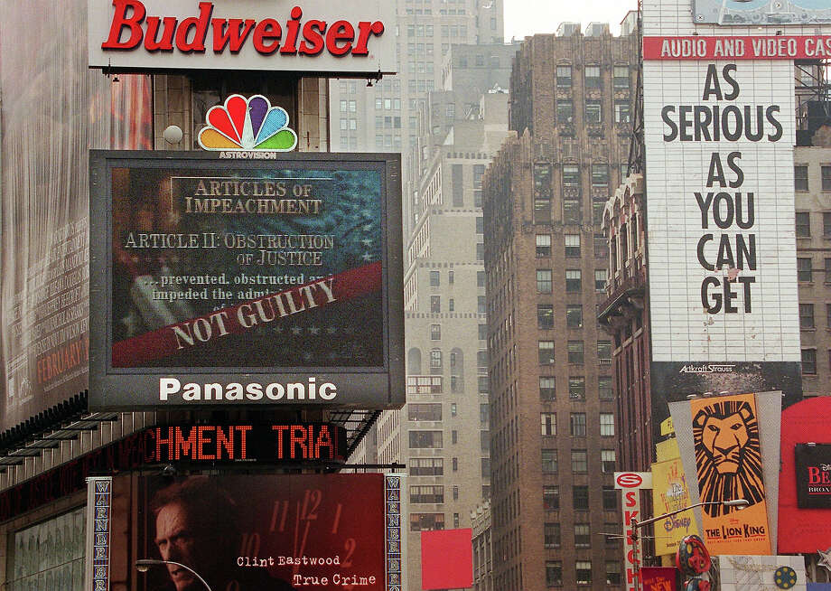 "The NBC jumbotron in Times Square displays the ""Not Guilty"" verdict on the Obstruction of Justice charges against US President Bill Clinton during his impeachment trial on Capitol Hill 12 February. The Senate failed to convict Clinton on charges of perjury and obstruction of justice. Photo: TIMOTHY A. CLARY, AFP/Getty Images / AFP"