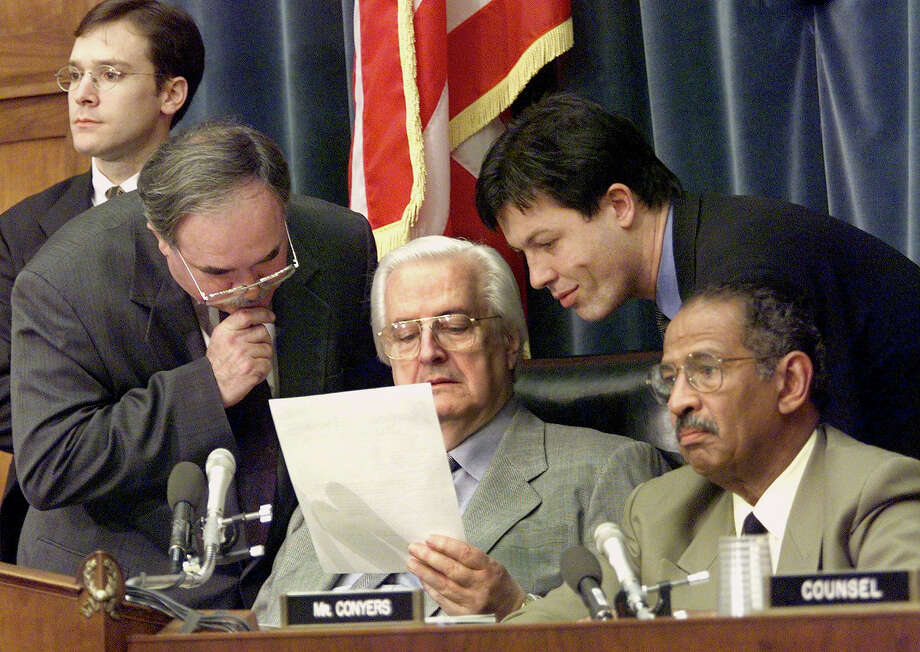 Majority Chief of Staff and General Counsel Thomas E. Mooney Sr. (2nd L), Chairman of the House of Representatives Judiciary Committee, Henry J. Hyde(R-IL)(C) and Minority Chief Counsel Julian Epstein (2nd R) review a document on the second day of President Bill Clinton's defense presentations in the impeachment inquiry against him on Capitol Hill in Washington. Photo: LUKE FRAZZA, AFP/Getty Images / AFP