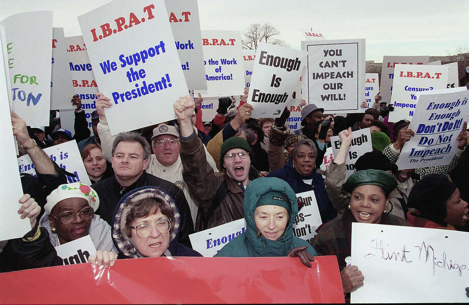 Protesters during an anti-impeachment rally on the West Front of the U.S. Capitol. Photo: Douglas Graham, Congressional Quarterly/Getty Im / CQ-Roll Call Group