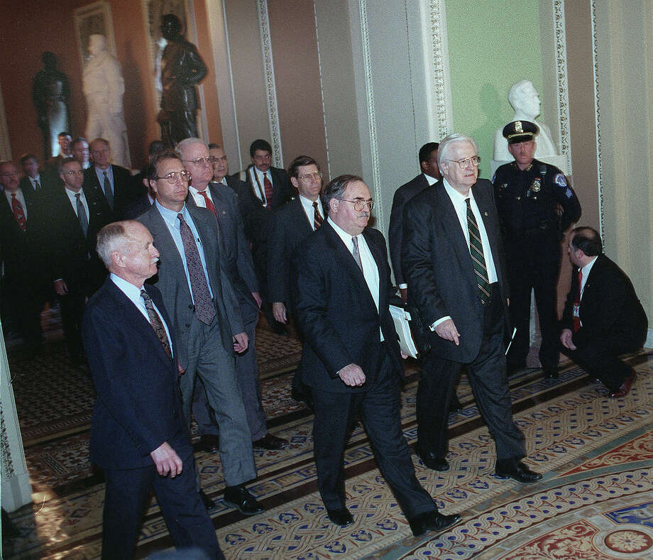 Chairman Henry J. Hyde,R-Ill., Tom Mooney, chief of staff for the House Judiciary Committee and House trail managers walk to the Senate Chamber to read the articles of impeachment. Photo: Douglas Graham, Congressional Quarterly/Getty Im / CQ-Roll Call Group