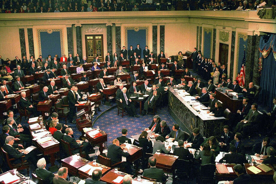 "The US Senate votes in its trial against impeached US President Bill Clinton on  February 12,1999  in Capitol Hill in Washington, DC. Clinton escaped removal from office and declared himself ""profoundly sorry"" for the year-long ordeal that led to his acquittal in the Senate impeachment trial. Photo: AFP, AFP/Getty Images / 1999 ImageForum"