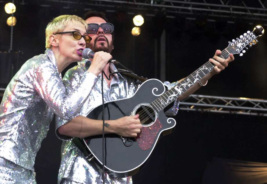 "File- This June 10, 2000, file photo shows Annie Lennox, left, and Dave Stewart as the Eurythmics performing on stage at the Rock at the Ring three-day music festival at the Nuerburgring race circuit in Nuerburg, Germany.  The Eurythmics are reuniting to pay tribute to the Beatles. The Recording Academy announced Monday Jan. 6, 2014, that  Lennox and Stewart will perform as a duo for ""The Night That Changed America: A Grammy Salute To The Beatles."" The event will tape at the Los Angeles Convention Center on Jan. 27, a day after the Grammy Awards. (AP Photo/Pool) ORG XMIT: NY108 Photo: AXEL SEIDEMANN / AP"