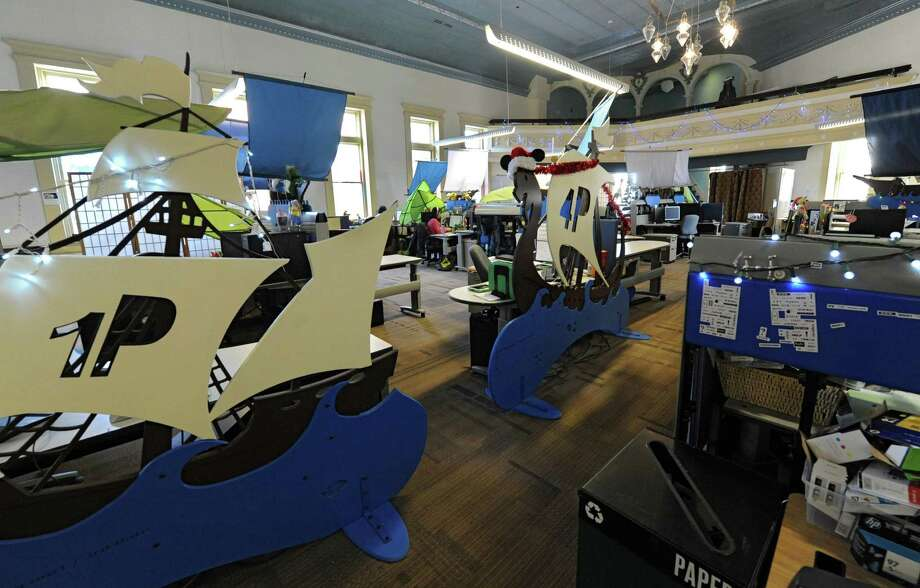 Employee desk areas are decorated with a design that looks like ships at 1st Playable Productions on Thursday, Dec. 19, 2013 in Troy, N.Y. 1st Playable Productions is a game development studio with a focus on handheld games for kids. (Lori Van Buren / Times Union) Photo: Lori Van Buren / 00025020A