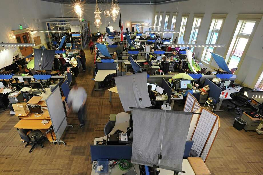 The big ball room, which is the main work area, as seen from the balcony at 1st Playable Productions on Thursday, Dec. 19, 2013 in Troy, N.Y. 1st Playable Productions is a game development studio with a focus on handheld games for kids. (Lori Van Buren / Times Union) Photo: Lori Van Buren / 00025020A