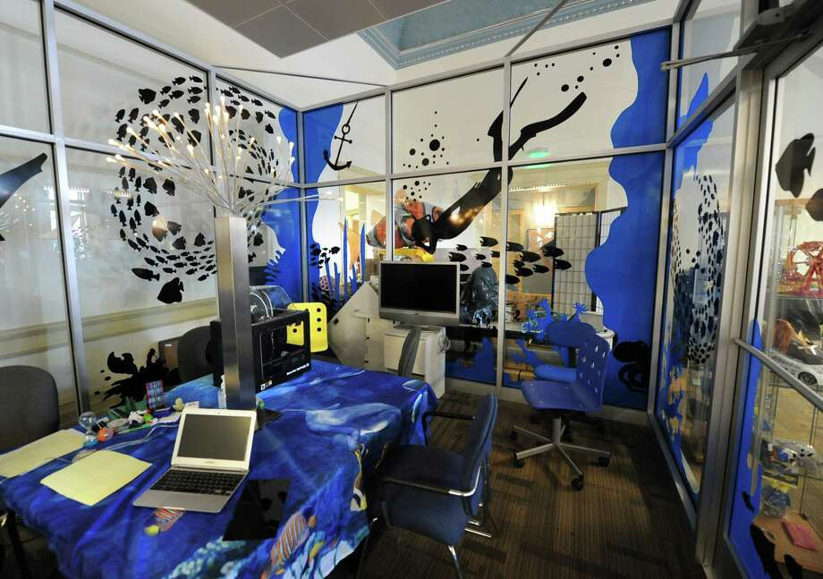 A conference room is decorated like a big aquarium at 1st Playable Productions on Thursday, Dec. 19, 2013 in Troy, N.Y. 1st Playable Productions is a game development studio with a focus on handheld games for kids. (Lori Van Buren / Times Union) Photo: Lori Van Buren / 00025020A
