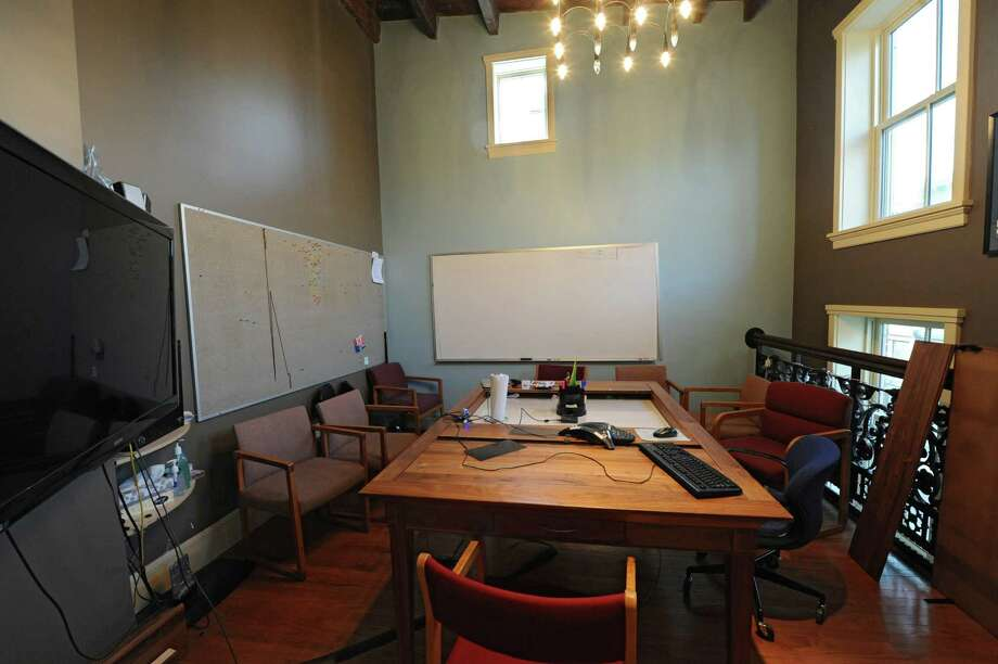 The Alice room is the main conference room at 1st Playable Productions on Thursday, Dec. 19, 2013 in Troy, N.Y. It got it's name because of the small window above. 1st Playable Productions is a game development studio with a focus on handheld games for kids. (Lori Van Buren / Times Union) Photo: Lori Van Buren / 00025020A