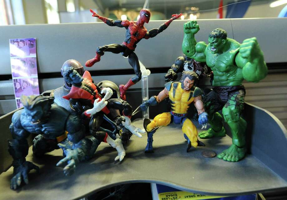 Action figures adorn an employees desk at 1st Playable Productions on Thursday, Dec. 19, 2013 in Troy, N.Y. 1st Playable Productions is a game development studio with a focus on handheld games for kids. (Lori Van Buren / Times Union) Photo: Lori Van Buren / 00025020A