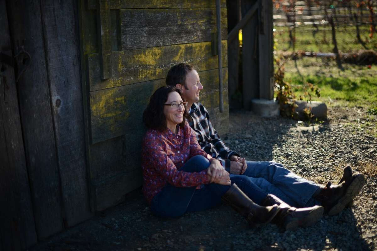 Steve and Jill Klein Matthiasson pose near the entrance to their barn at their home in Napa.