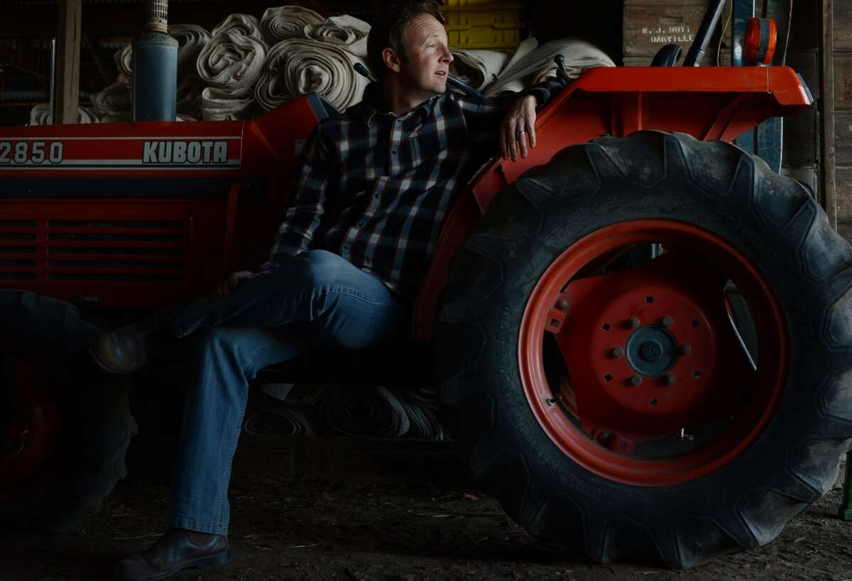 Winemaker Steve Matthiasson with his Kubota tractor in his barn at his home in Napa.