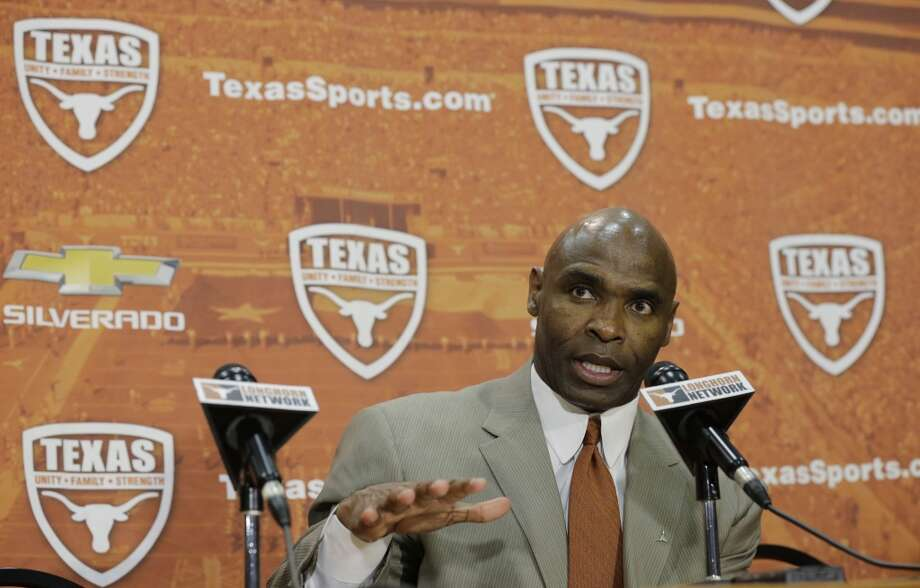 Charlie Strong answers questions during a news conference where he was introduced as the new Texas football coach. Photo: Eric Gay, Associated Press