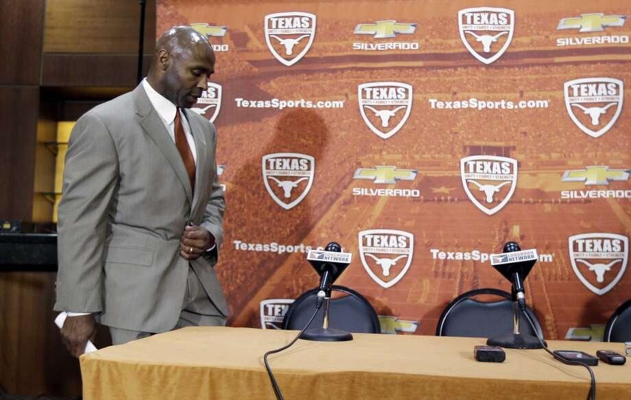 Charlie Strong arrives for a news conference where he was introduced as the new Texas football coach. Photo: Eric Gay, Associated Press