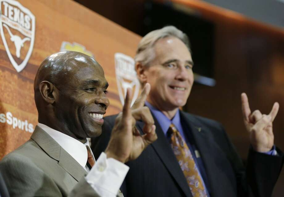 "New Texas football Charlie Strong, left, poses for a photo with athletic director Steve Patterson, right, both displaying the ""Hook 'em Horns"" sign, following a news conference announcing Strong's hire. Photo: Eric Gay, Associated Press"