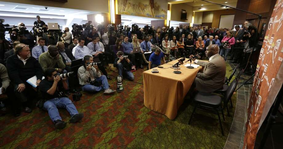 Charlie Strong, right, answers questions during the news conference. Photo: Eric Gay, Associated Press