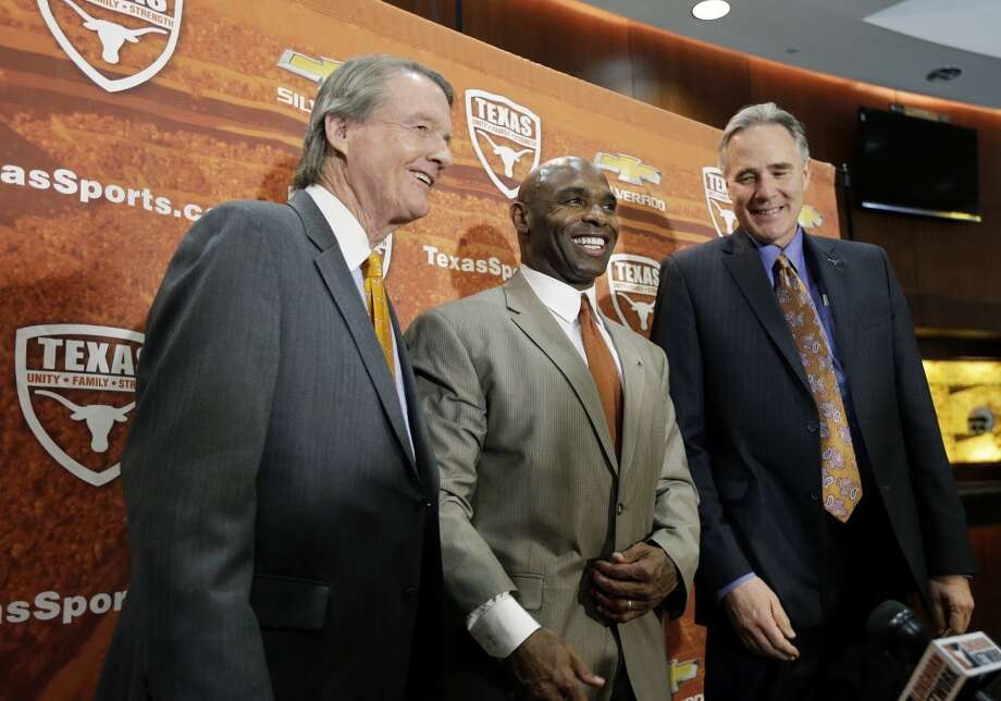 Charlie Strong, center, poses with Texas president Bill Powers, left, and athletic director Steve Patterson, right, following the introductory news conference. Photo: Eric Gay, Associated Press