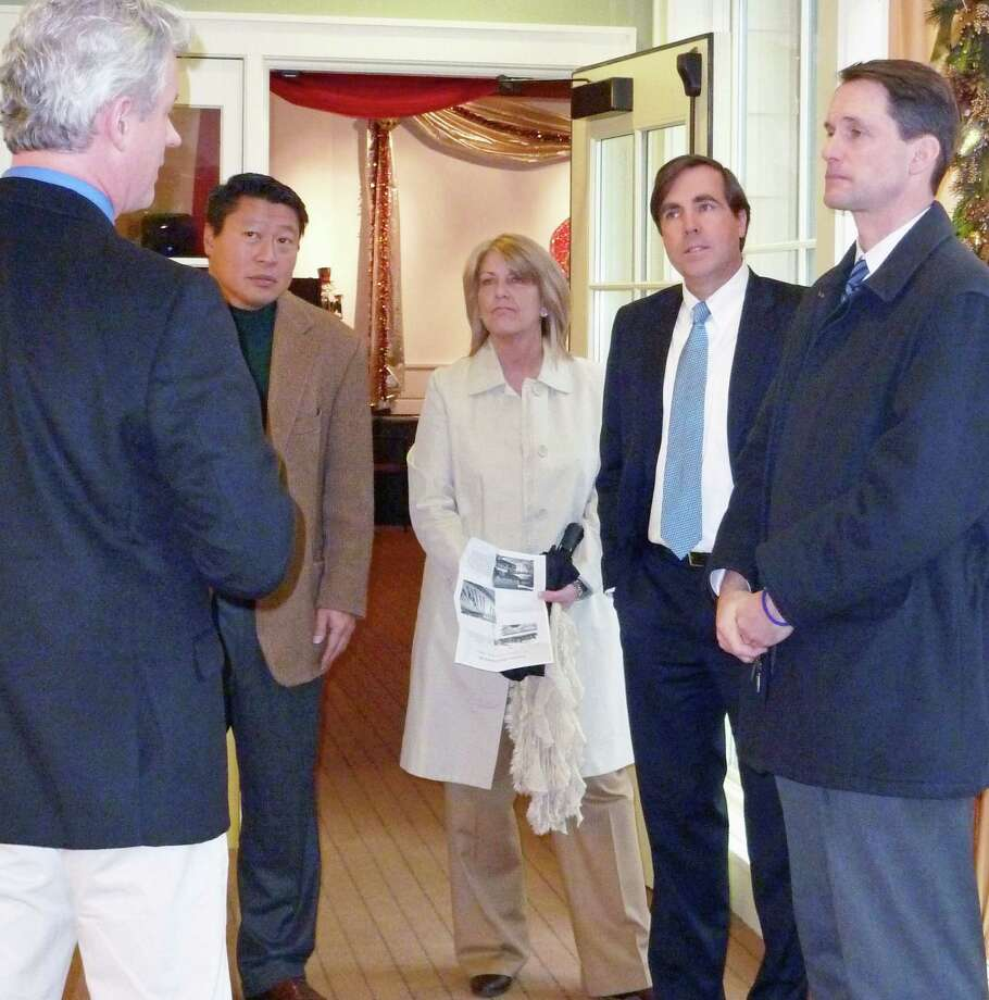 Michael Jehle, executive director of the Fairfield Museum and History Center, gives a tour to, from left to right, state Rep. Tony Hwang, R-134, state Rep. Brenda Kupchick, R-132, Thomas Walsh, president of the museum board, and U.S. Rep. Jim Hime, D-4. Photo: Genevieve Reilly / Fairfield Citizen