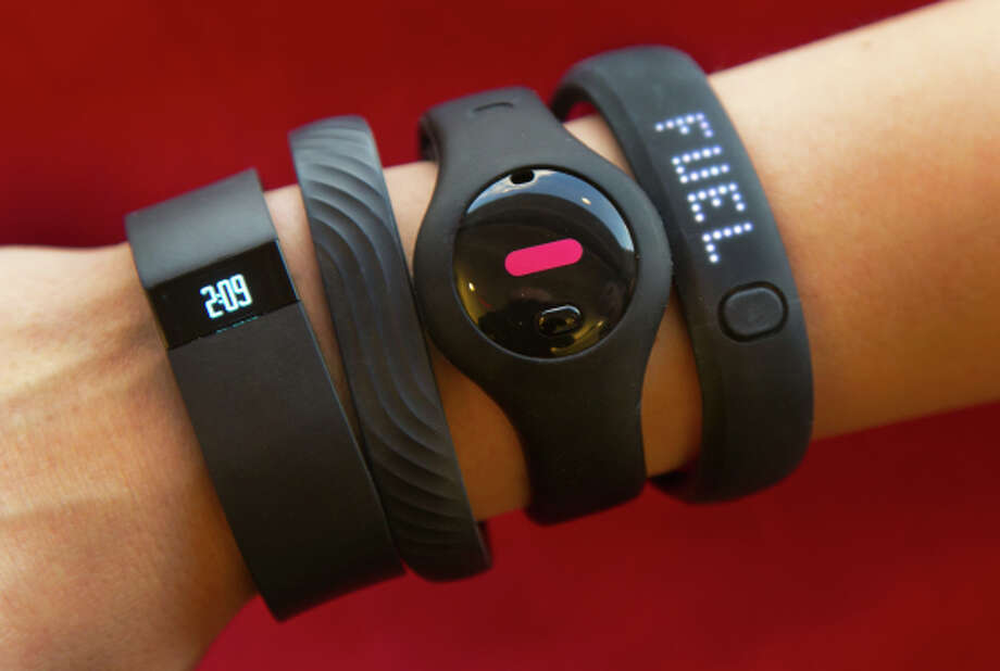 Some of the top-selling health devices include the Fitbit Force, Jawbone Up, Fitbug Orb and Nike FuelBand SE. Photo: Richard Drew / Associated Press / AP