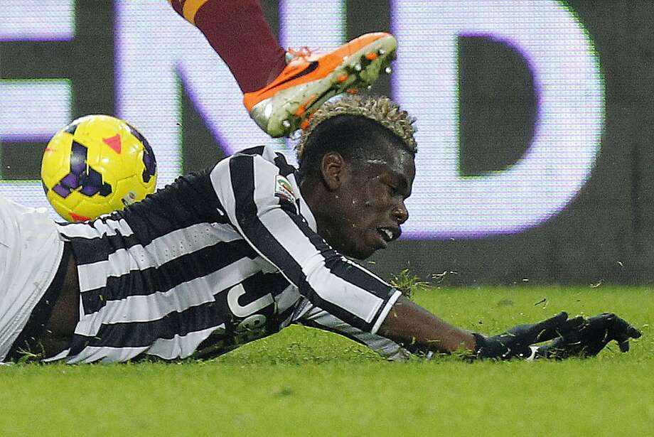 Spiked hair: Juventus' midfielder Paul Pogba gets run over during the Juventus-Roma match in Turin. Photo: Marco Bertorello, AFP/Getty Images