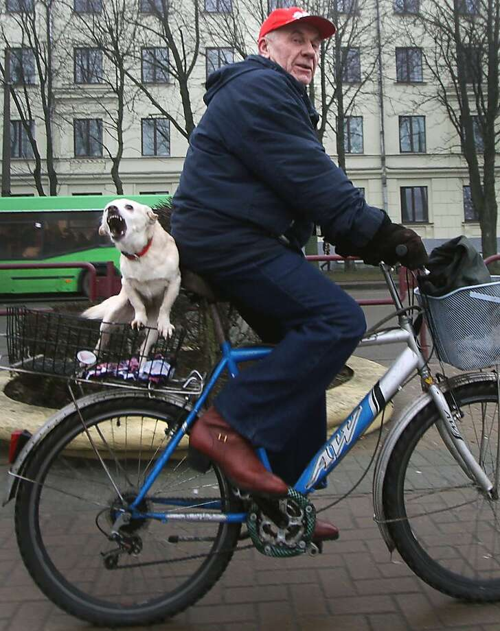 One more crack about my '70s disco boots, and I'll release the hound. (Bicyclist in downtown Minsk.) Photo: Sergey Gapon, AFP/Getty Images