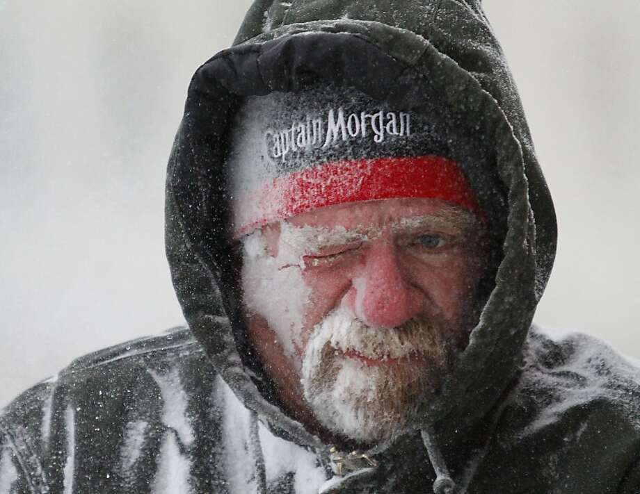 There's a little Captain and a lot of ice on Allan Umscheid, who was running a snow blower at his business in Lawrence, Kan., where wind-chill temperatures hovered around minus-30 degrees. Photo: Mike Yoder, Associated Press
