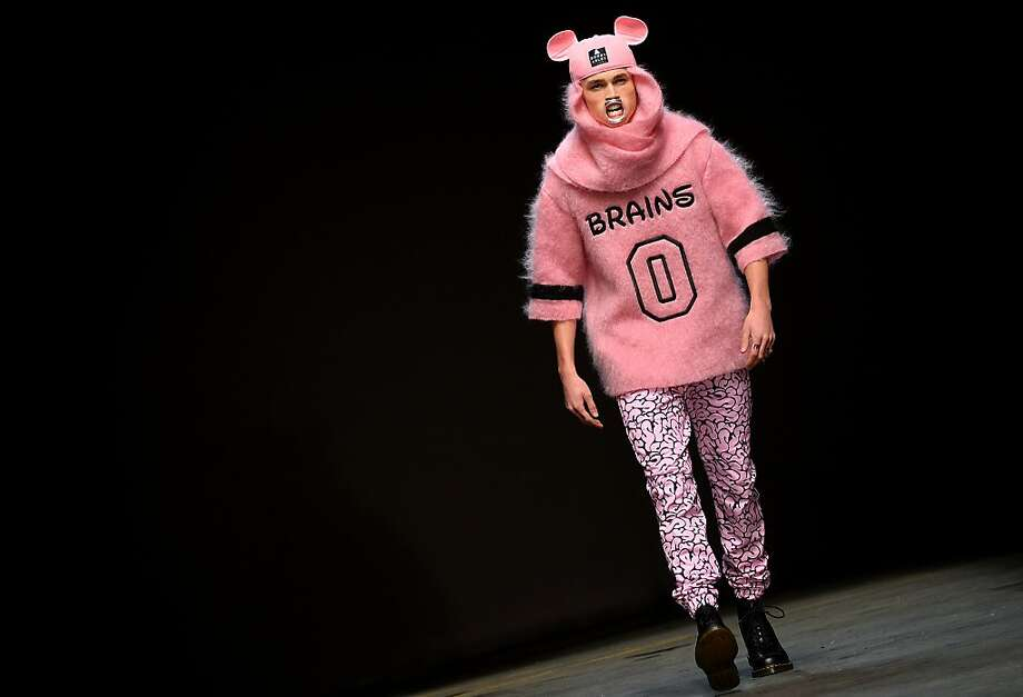 Here comes the brains of the outfit: A Bobby Abley design makes a statement at the Autumn/Winter 2014 London Collections men's fashion event. And that statement is, men should dress like pink Mouseketeers. Photo: Ben Stansall, AFP/Getty Images