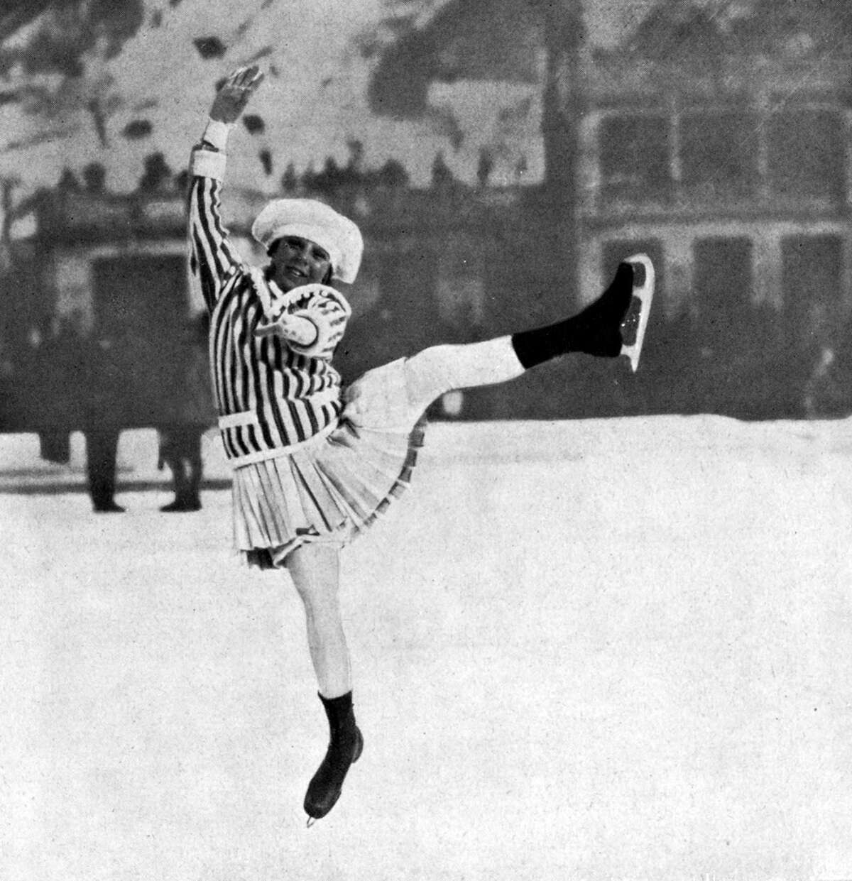 1924: Norway's Sonja Henie is pictured competing in her first Olympic Games at the age of 11. She later became the most famous figure skater of all time.