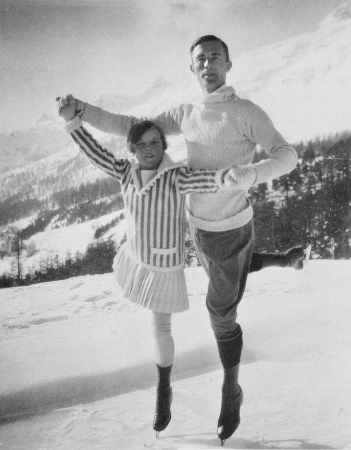 Figure skaters Sonja Henie, 11, of Norway and Gilles Grafstrom of Sweden pose at the Olympic Games in Chamonix, France, in 1924.  Henie placed eighth of eight in the ladies' singles, but would win the gold in the 1928, 1932 and 1936 Winter Olympic Games. Grafstrom won the Olympic gold medal in the men's singles in 1924. He also won gold in the 1920 and 1928 games. Photo: ANONYMOUS, Associated Press / AP