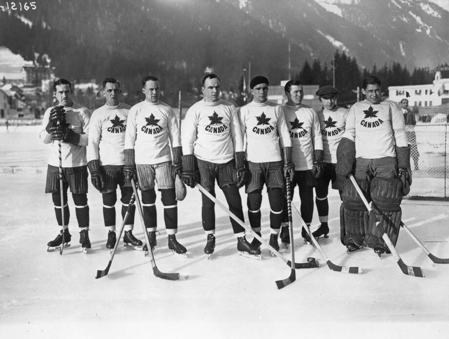 The Canadian ice hockey team, the Toronto Granites, are seen after beating the United States to take the Olympic gold medal at the Winter Games in Chamonix, France, in February 1924. Photo: Topical Press Agency, Getty Images / Hulton Archive