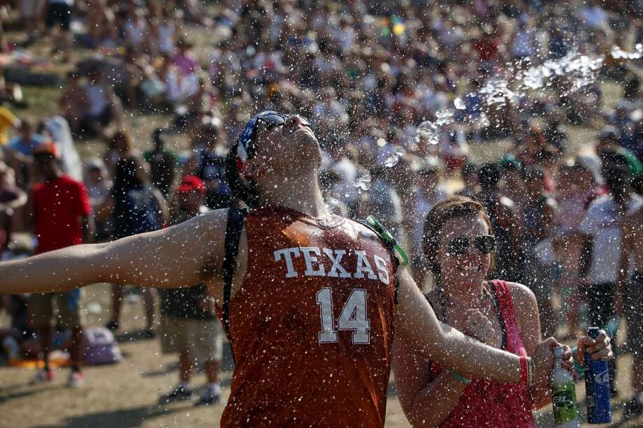 Paul Thannisch, left, and friend, Allie Johnson, get sprayed with a water canon during day 1 of Summerfest, Saturday, June 4, 2011, at Eleanor Tinsley Park in Houston, Texas. (Todd Spoth/For The Chronicle) Photo: TODD SPOTH, For The Chronicle