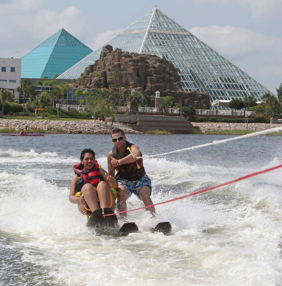 Edith Garcia left, is assisted by volunteer Stewart Austin right, while water skiing during the Moody Gardens Adaptive Water Sports Festival at Moody Gardens' Palm Beach Marina Saturday, Sept. 8, 2012, in Galveston. ( James Nielsen / Chronicle ) Photo: James Nielsen, Houston Chronicle