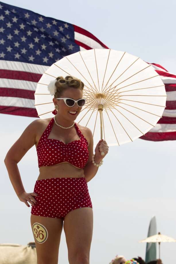 Ashley Cargle shows off her bathing suit during the Beach Revue bathing beauties contest on Saturday, May 18, 2013, in Galveston. Forty contestants wore 20's and 30's period style bathing suits and competed for cash prizes during this crowd favorite event.  ( J. Patric Schneider / For the Chronicle ) Photo: J. Patric Schneider, For The Houston Chronicle
