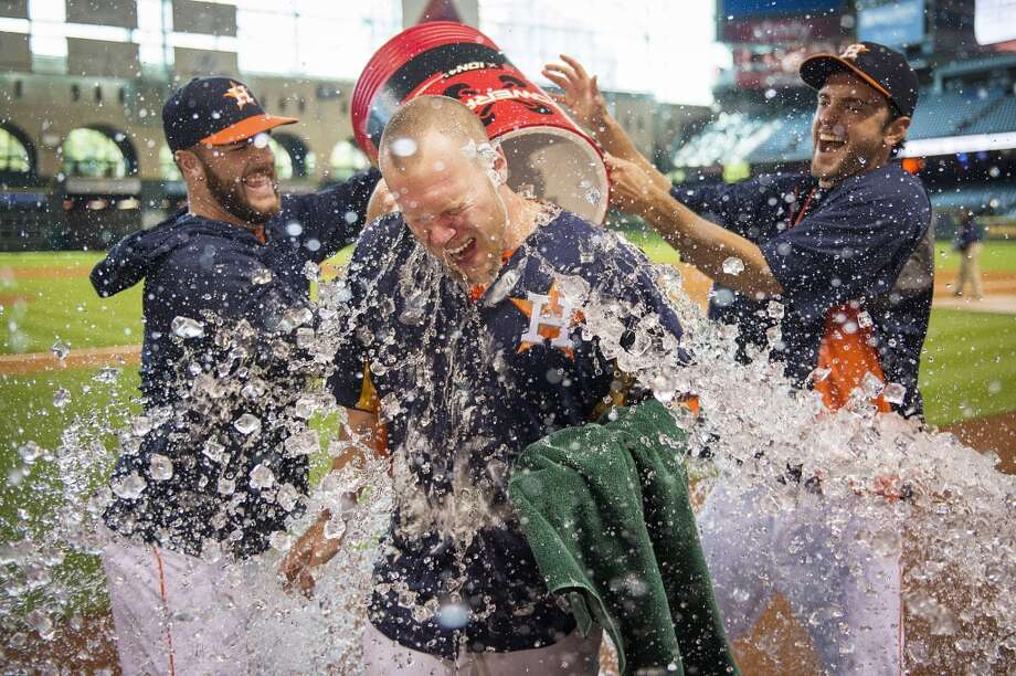 Houston Astros starting pitcher Brett Oberholtzer, center, is doused by his teammates after pitching a complete baseball game shutout against the Seattle Mariners at Minute Maid Park on Sunday, Sept. 1, 2013, in Houston. The Astros won 2-0. (AP Photo/Houston Chronicle, Smiley N. Pool) Photo: Smiley N. Pool, Associated Press