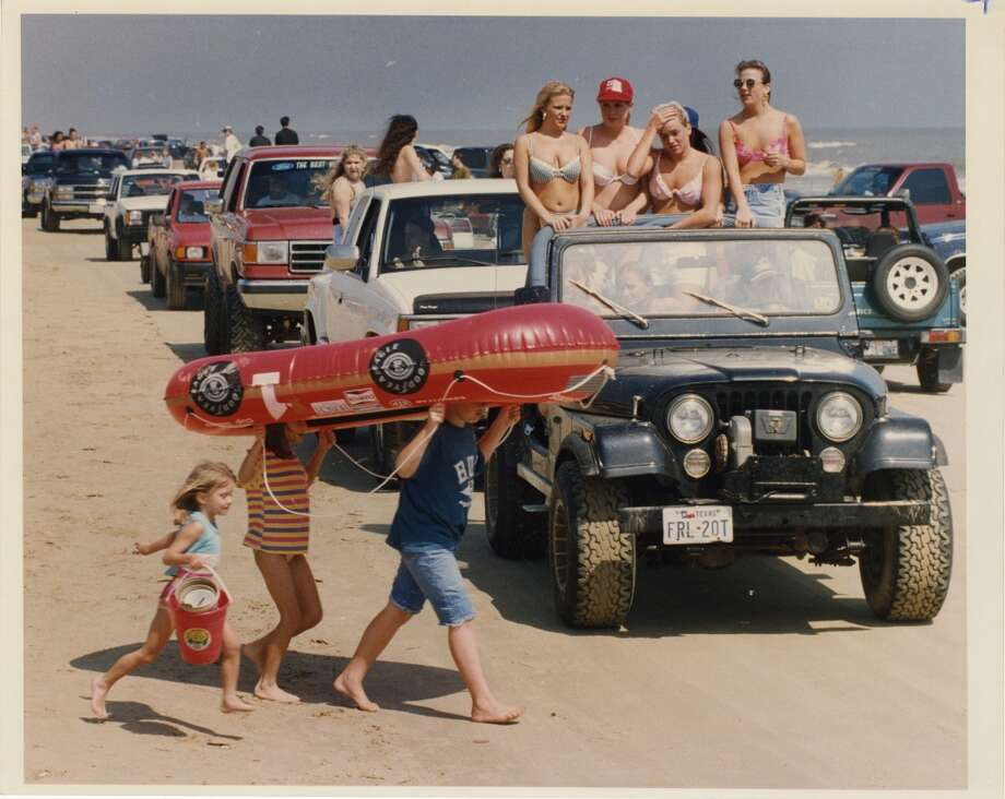 Seems families and teenage spring breakers must look out for one another on Crystal Beach along the Bolivar Peninsula so all can have a fun, enjoyable time in the sun. The beach was packed with hoards of high school and college spring breakers trying to stake their piece of the beach. March 18, 1994 Photo: Ira Strickstein, Houston Chronicle