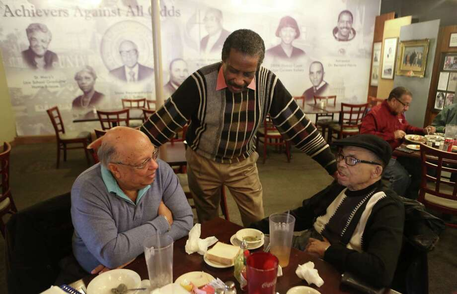 Charles Andrews, Tommy Moore and Dr. Robert Hilliard speak during lunch Jan. 2. Moore said Andrews was his first customer. The restaurant closed Saturday after unsuccessful negotiations with financiers. Photo: San Antonio Express-News / ©2013 San Antonio Express-News