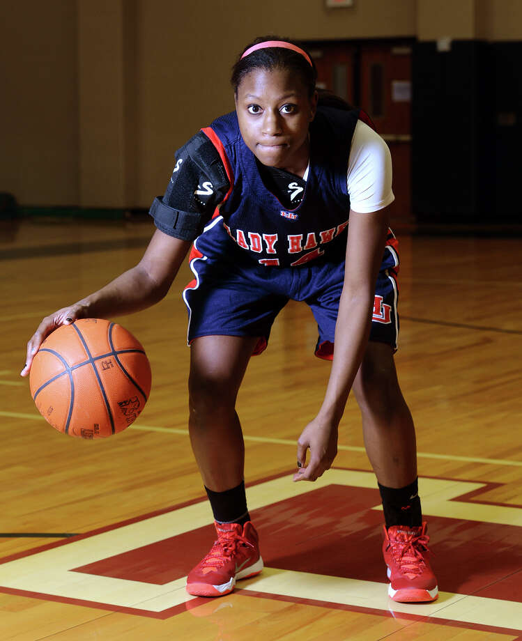 Hardin-Jefferson High School senior guard Kesha Broussard poses for portraits in the gymnasium Monday, Dec. 30, 2013. Broussard said she has been playing basketball since she was three. Photo taken Monday, 12/30/13 Jake Daniels/@JakeD_in_SETX Photo: Jake Daniels / ©2013 The Beaumont Enterprise/Jake Daniels