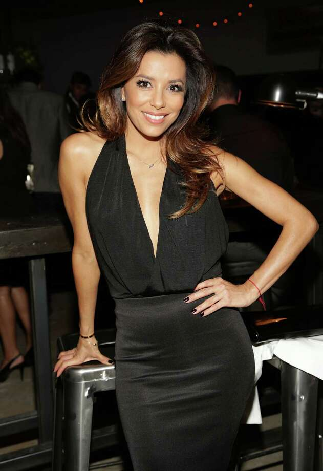 Actress Eva Longoria attends Moments In Motion, An Exclusive Unveiling Of Never Before Seen Photos At De Nolet, Miami For Art Basel on December 5, 2013 in Miami, Florida. Photo: Alexander Tamargo, Getty Images For Ketel One / 2013 Getty Images