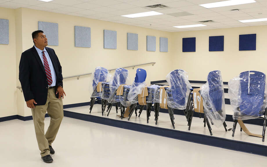 Principal Henry Yzaguirre checks out a classroom at the new South San High School, part of a bond package, last summer. A reader says that unless we support public schools, democracy is in jeopardy. Photo: JERRY LARA / San Antonio Express-News / © 2013 San Antonio Express-News