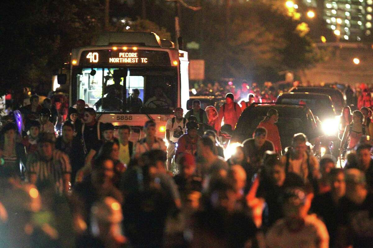 Thousands of bicyclists block a bus and cars along Houston Avenue during the October Critical Mass ride.