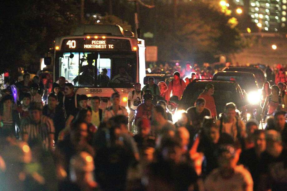 Thousands of bicyclists block a bus and cars along Houston Avenue during the October Critical Mass ride. Photo: James Nielsen, Staff / © 2013  Houston Chronicle