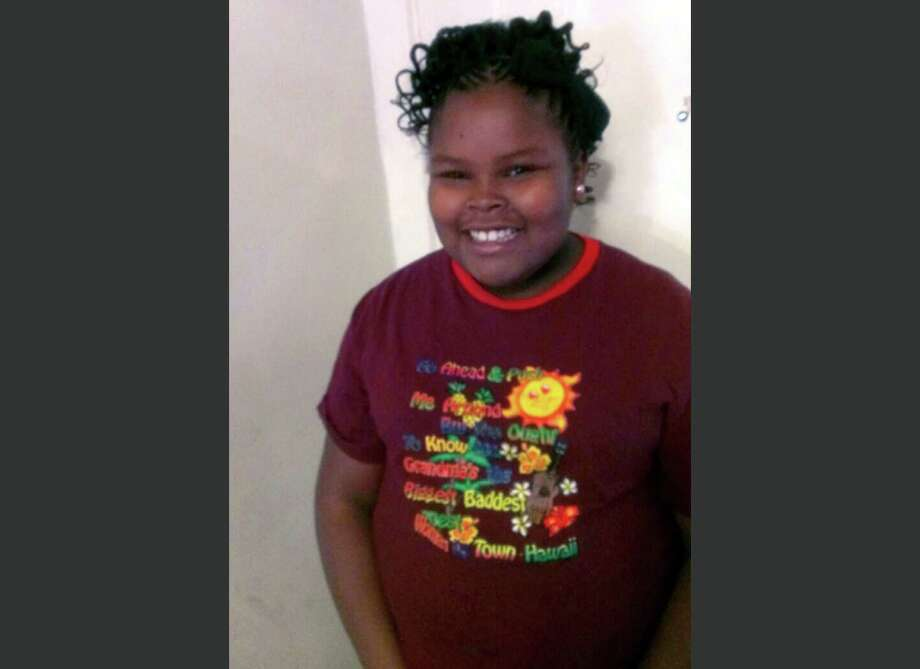 File - This undated file photo provided by the McMath family and Omari Sealey shows Jahi McMath. The family attorney of the California girl declared brain dead after a tonsillectomy says she has been taken out of Children's Hospital of Oakland. Christopher Dolan tells The Associated Press that McMath left the hospital in a private ambulance shortly before 8 p.m. Sunday Jan. 5, 2014. (AP Photo/Courtesy of McMath Family and Omari Sealey, File) Photo: Uncredited, HONS / McMath Family and Omari Sealey