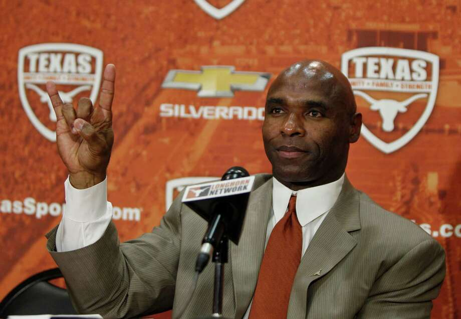 "AUSTIN, TX - JANUARY 6: The University of Texas Longhorns new head football coach Charlie Strong from Louisville flashes the ""Hook 'Em Horns"" sign after being introduced during a press conference January 6, 2014 at Darrell K. Royal-Texas Memorial Stadium in Austin, Texas.  (Photo by Erich Schlegel/Getty Images) Photo: Erich Schlegel, Stringer / 2014 Getty Images"
