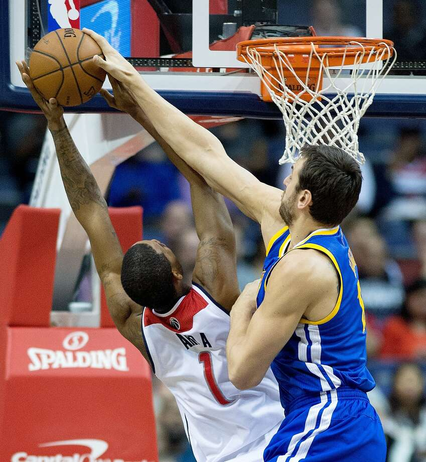 Golden State Warriors center Andrew Bogut (12) blocks the shot of Washington Wizards small forward Trevor Ariza (1) during the first half of their game played at the Verizon Center in Washington, Sunday, Jan. 5, 2014. (Harry E. Walker/MCT) Photo: Harry E. Walker, McClatchy-Tribune News Service
