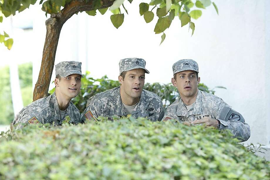 "Randy (Parker Young, left), Pete (Geoff Stults) and Derrick (Chris Lowell) are brothers in ""Enlisted."" Photo: Greg Gayne, Fox"