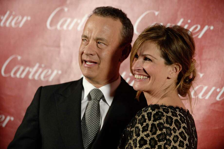 Tom Hanks, left, and Julia Roberts pose backstage at the Palm Springs International Film Festival Awards Gala at the Palm Springs Convention Center on Saturday, Jan. 4, 2014, in Palm Springs, Calif. (Photo by Jordan Strauss/Invision/AP) ORG XMIT: CAJS110 Photo: Jordan Strauss / Invision