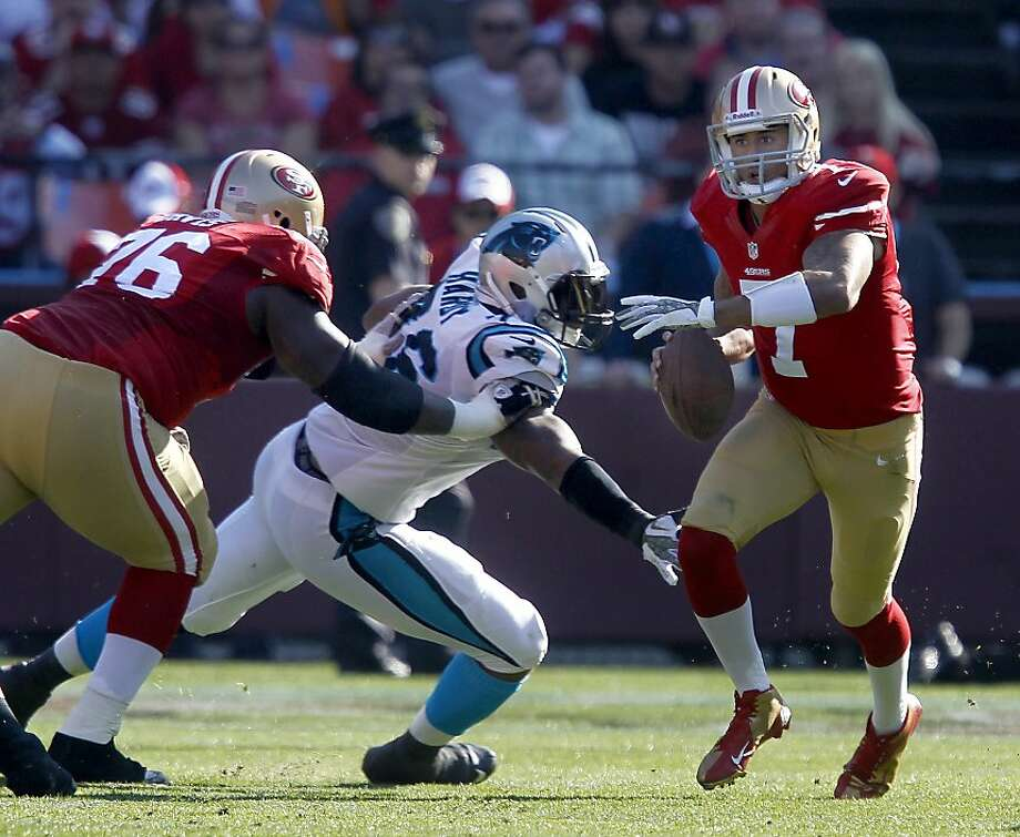 Colin Kaepernick (7) ran out of trouble for a short gain in the first half Sunday November 10, 2013. The San Francisco 49ers were beaten by the Carolina Panthers 10-9 at Candlestick Park. Photo: Brant Ward, The Chronicle