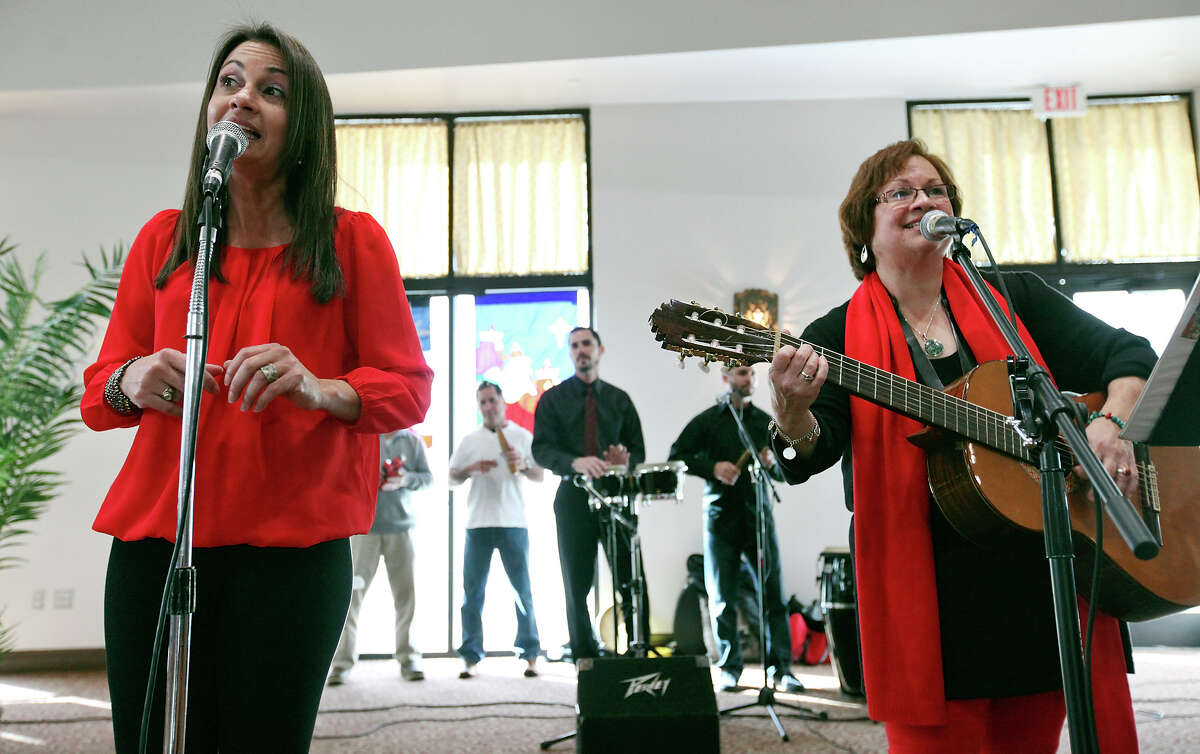 Roche Rodriguez (left) and Lourdes Gonzalez of the band Los Primos perform with the group during the Puerto Rican Heritage Society's Three Kings Day celebration held Sunday Jan. 5, 2014 at the AT&T Community Centre at San Fernando.