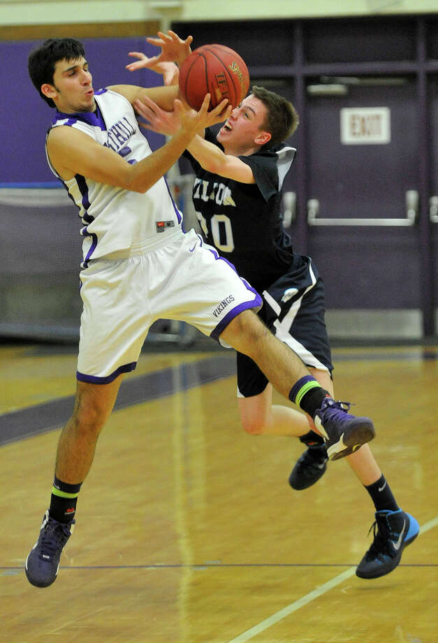 In the final seconds of the game, Wilton's Michael Bingaman attempts to pick off an inbound pass to Westhill's Evan Skoparantzas during their basketball game at Westhill High School in Stamford, Conn., on Monday, Jan. 6, 2014. Westhill won, 51-43. Photo: Jason Rearick / Stamford Advocate