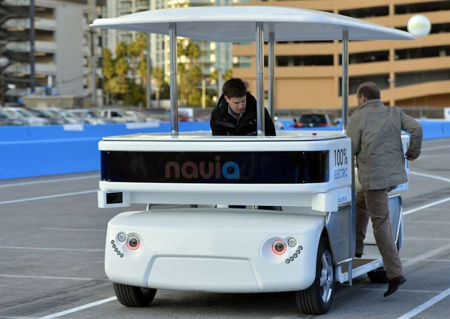 Induct demonstrates their new Navia driverless shuttle. Photo: Jack Dempsey, Associated Press