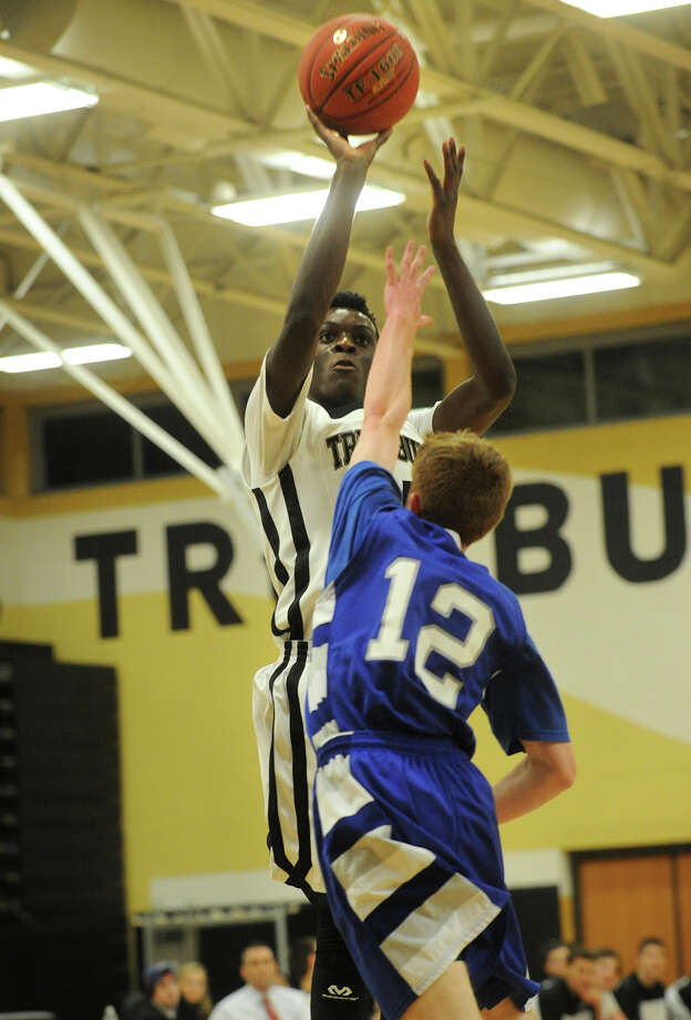 Trumbull's Matt Turner fires off a jumper over Fairfield Ludlowe defender Mark Malone during their FCIAC boys basketball game at Trumbull High School in Trumbull, Conn. on Monday, January 6, 2013. Photo: Brian A. Pounds / Connecticut Post